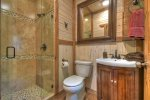 Guest House Bathroom with a tile shower